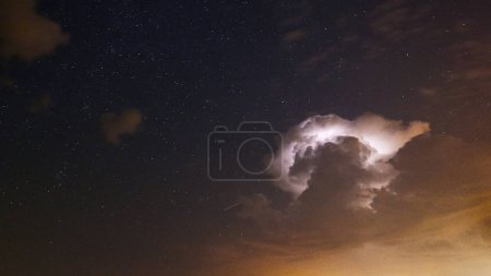 Photo for Starry night with Thunderstorm - Royalty Free Image