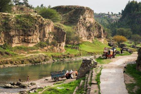 Villagers enjoying fresh water stream in province of Khyber Pukhtunkhwa, Pakistan.