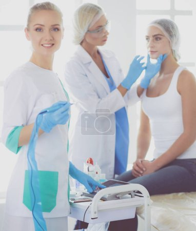Beautiful woman face near doctor with syringe