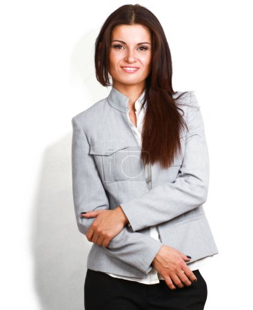 Portrait of beautiful business woman standing with folded arms, isolated on white