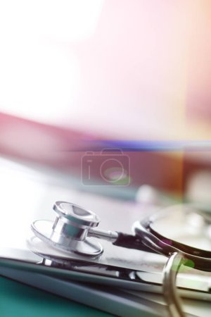 Medical equipment: blue stethoscope and tablet on white background. Medical equipment
