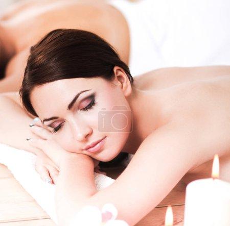Two beautiful women getting massage in spa