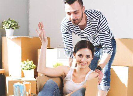Photo for Happy young couple unpacking or packing boxes and moving into a new home. young couple. - Royalty Free Image