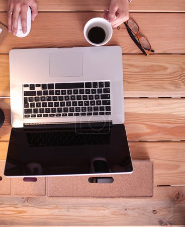 Photo for Young female working sitting at a desk - Royalty Free Image