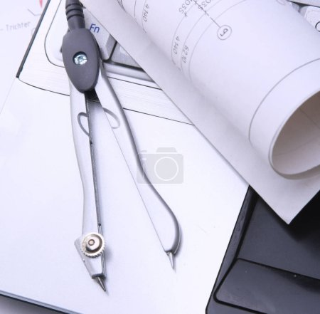 Blue print and plans with drawing compass
