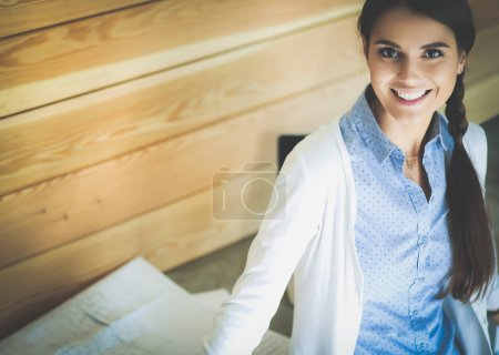Photo for Young female standing near desk at home. The woman at the table. Workplace - Royalty Free Image
