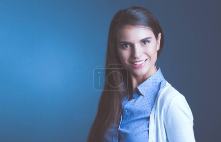 Photo for Portrait of a businesswoman , against dark background. Woman smiling. Portrait of a woman. - Royalty Free Image