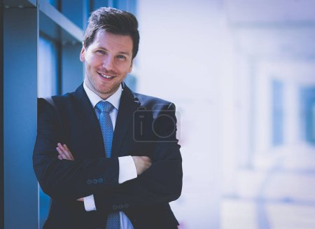 Photo for Portrait of businessman standing near window in office . - Royalty Free Image