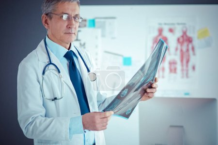 Photo for Male doctor writes notes on the clipboard in the hospital. - Royalty Free Image
