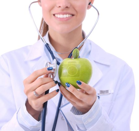 Photo for Medical doctor woman examining apple with stethoscope. Woman doctors. - Royalty Free Image
