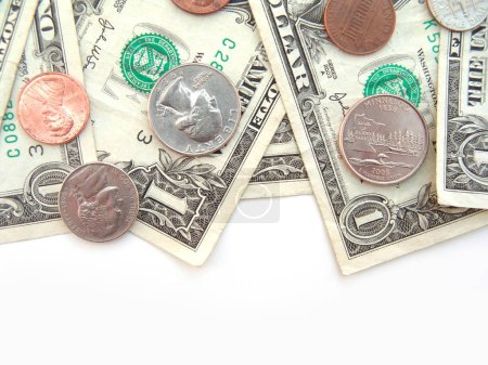Photo for Pocket change dollars and cents on white surface - Royalty Free Image