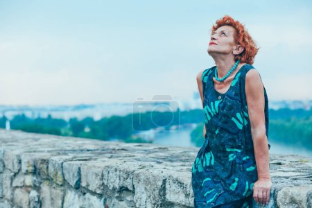 Photo for Depressed mature woman feeling alone outside - Royalty Free Image