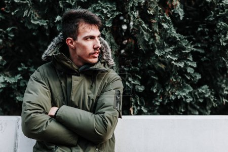 Photo for Young man in winter jacket posing outdoors - Royalty Free Image