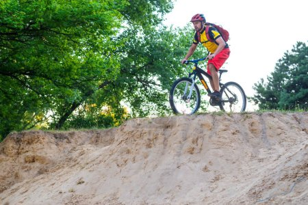 ?oncept of an active lifestyle, a cyclist riding a mountain bike, a bright summer photo. The extreme sport, enduro, mtb.