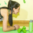 Woman doing fitness exercise, young woman doing fi...
