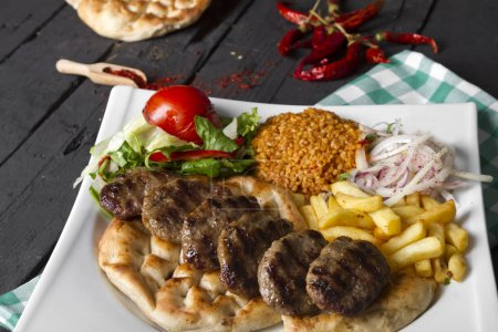 Photo for Delicious Turkish Traditional Ramadan Kebab on wooden tabletop - Royalty Free Image
