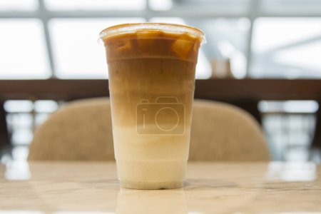 Ice caramel latte coffee without cream in take a w...