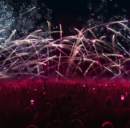Photo for Crowded people with fireworks and red colored. - Royalty Free Image