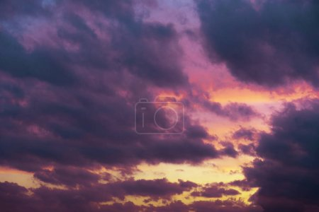 Photo for Cloudy sky on sunset with blue and yellow colors. - Royalty Free Image