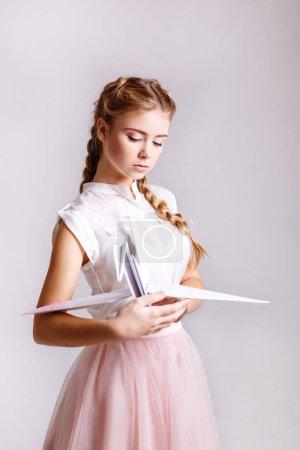 Charming teenager girl in studio, makeup Glitter, origami and minimalism Pastel tones, closeup, studio lighting, retouched.