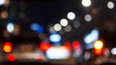 Defocus car tail lights in the night traffic. The shot was taken by altering the lens focus ring.