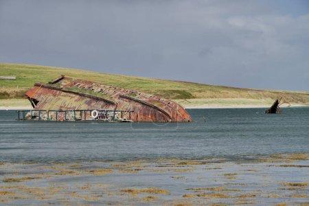 A rusting, sunken World War 2 block ship off Churc...