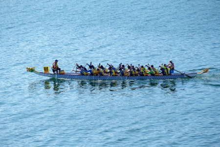 Tolo Harbour, Hong Kong, China - 2 December 2018: The 9 th Hong Kong Half Marathon Dragon Boat Championships organized on Sunday. Two race distances  Half Marathon 21.0975km and 10km. Adjudicator in rubber dinghy.