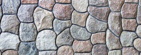 Photo pour Texture et motif de paroi rocheuse naturelle. Une surface faite de blocs de pierre. - image libre de droit