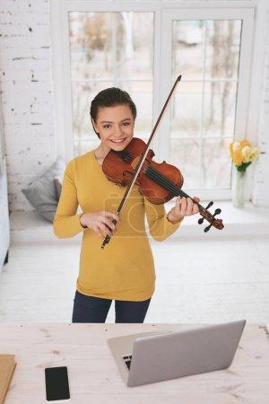 Joyful schoolgirl learning classical melody