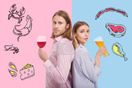 Waist up of young couple drinking alcohol back to back