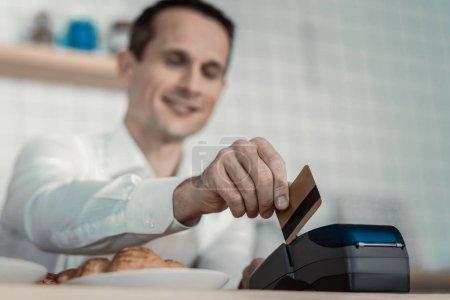 Pleased waiter transferring money into account