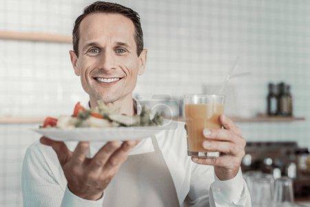 Portrait of smiling man that posing on camera