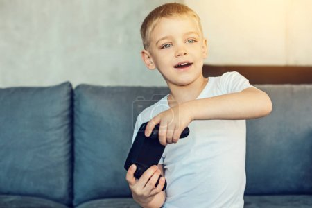 Little boy with games console in his hands