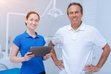 Happy stomatologists looking straight at camera