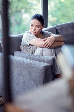 Sorrowful sad woman changing routine