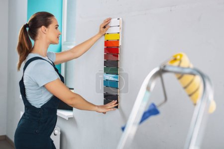 Inspired designer choosing a paint for walls