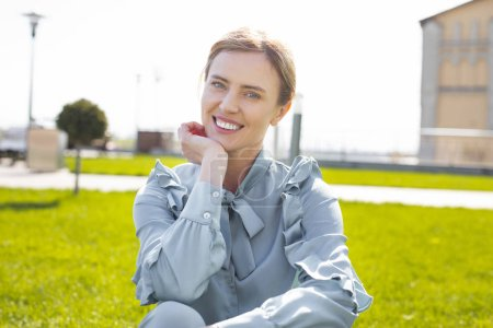 Smiling woman feeling extremely happy after getting promotion