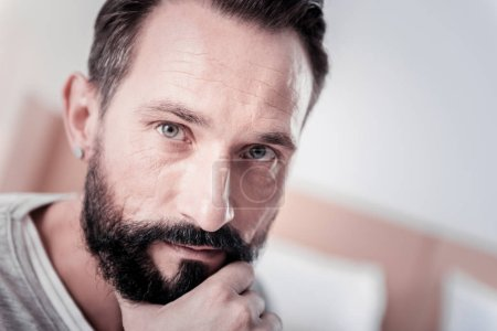 Photo for My thoughts. Concentrated bearded man thinking and holding his chin - Royalty Free Image