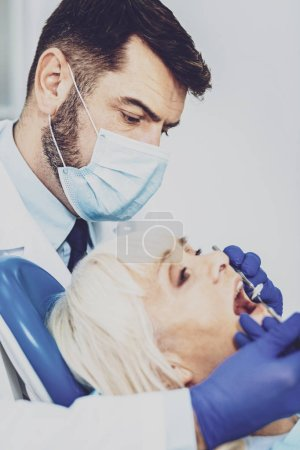 Portrait of professional dentist that treating patient