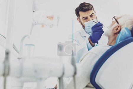 Competent stomatologist treating his patient