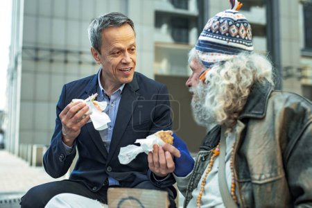 White collar worker taking care of street person