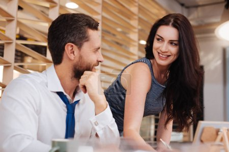 Cheerful woman flirting with her boss