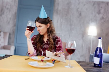 Photo for Friendless and lonely. Blue-eyed woman wearing fashionable blouse feeling very friendless and lonely while sitting alone - Royalty Free Image