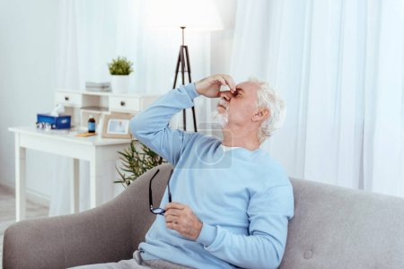 Tranquil senior man having headache
