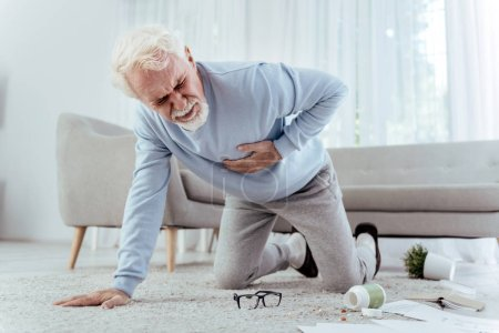 Sick senior man falling from heart attack