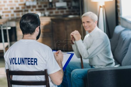 Inspired volunteer conducting a poll
