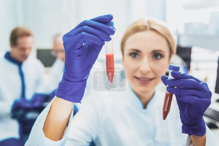 Delighted blonde woman examining reagents