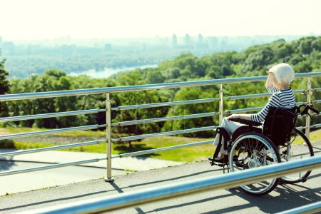 Disabled woman looking the city view