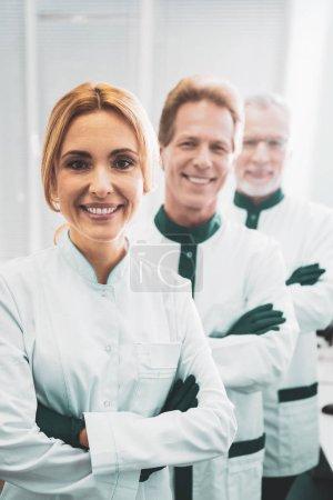 Chief blonde-haired bioengineer organizing staff meeting