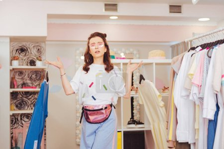 Dark-haired shopaholic feeling emotional in new shopping mall